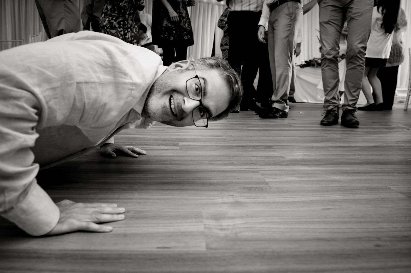 man peeking into camera on floor