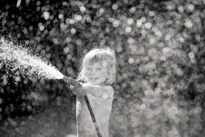 Little girl spraying water