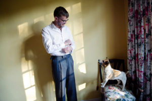 Groom with small dog