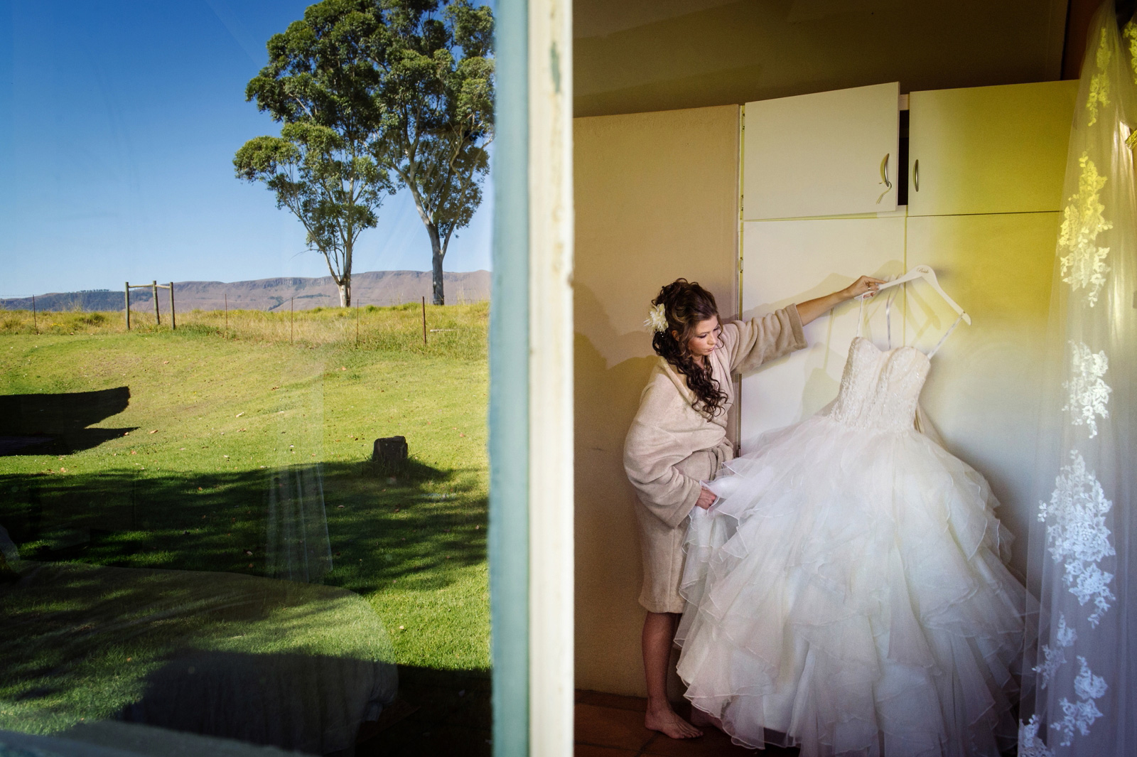 Bride with wedding dress in the country