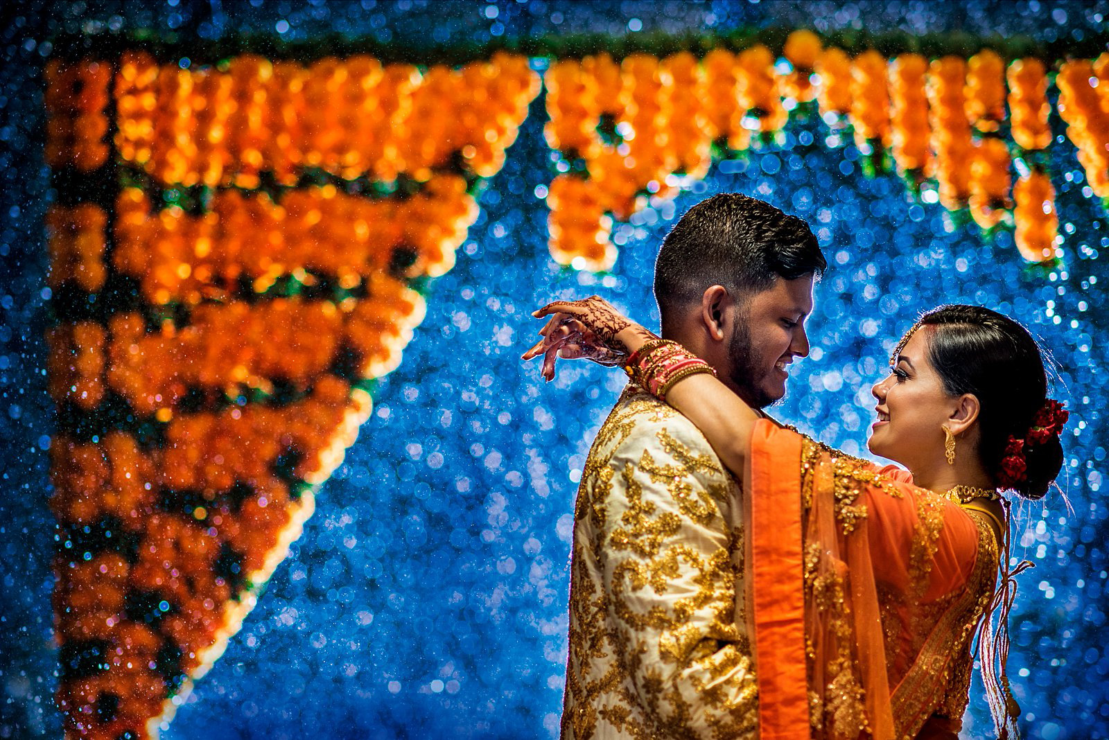 Hindu couple in the rain creative wedding photo