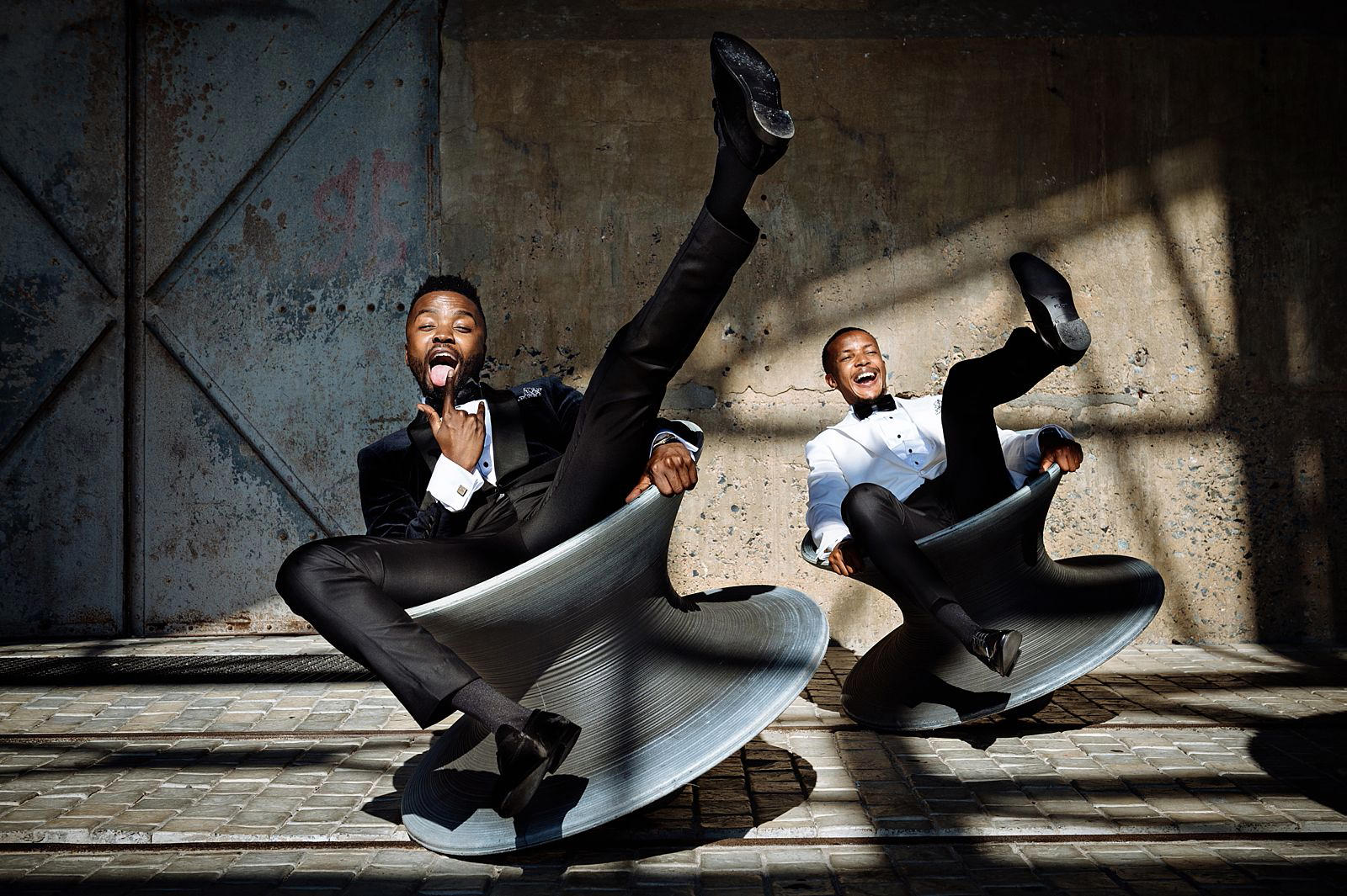 Fun wedding photo of two grooms at the Zeitz MOCCA Cape Town