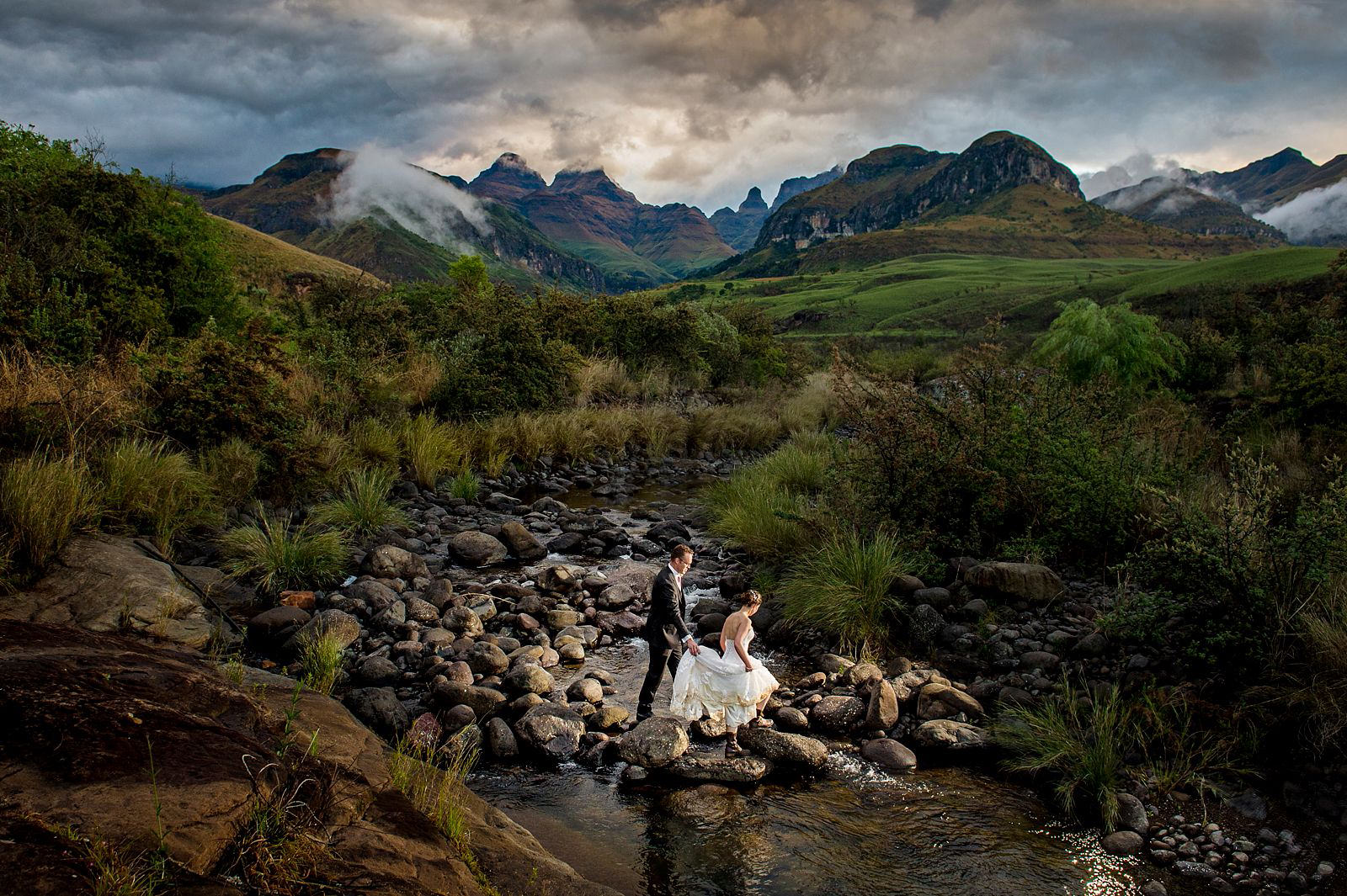 Creative wedding photography in the Drakensberg mountains, Cathedral Peak.