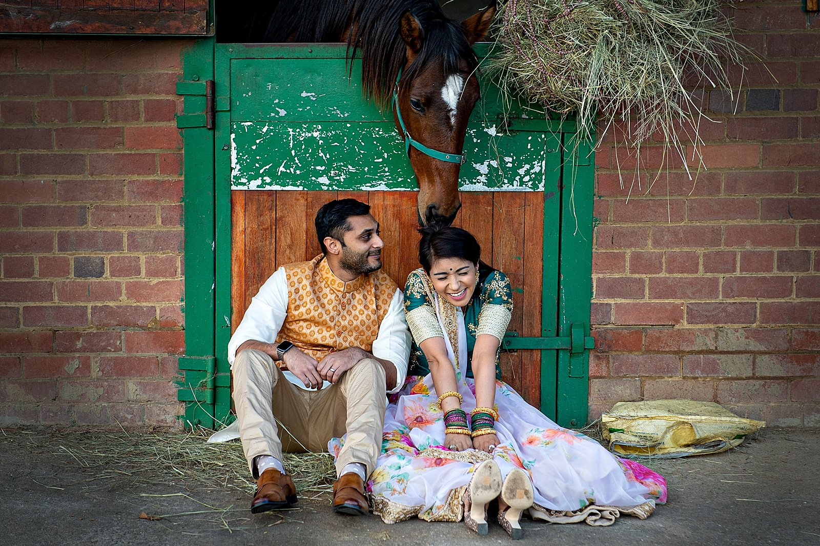 Creative Hindu wedding shot by top South African Creative photographer, Jacki Bruniquel. Shot at Hartford House at sunset with horses.