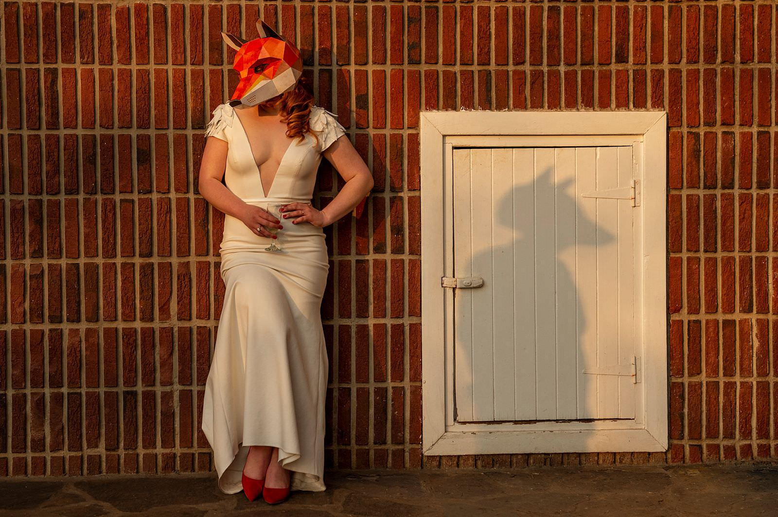 Bride with fox mask in Wes Anderson themed wedding
