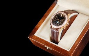 jewelry wristwatch with leather bracelet in wooden box