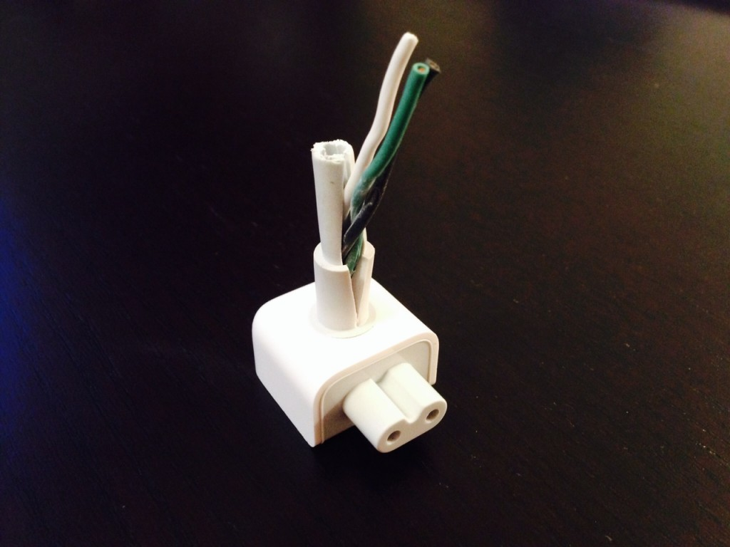 Dissected MacBook power cord connection