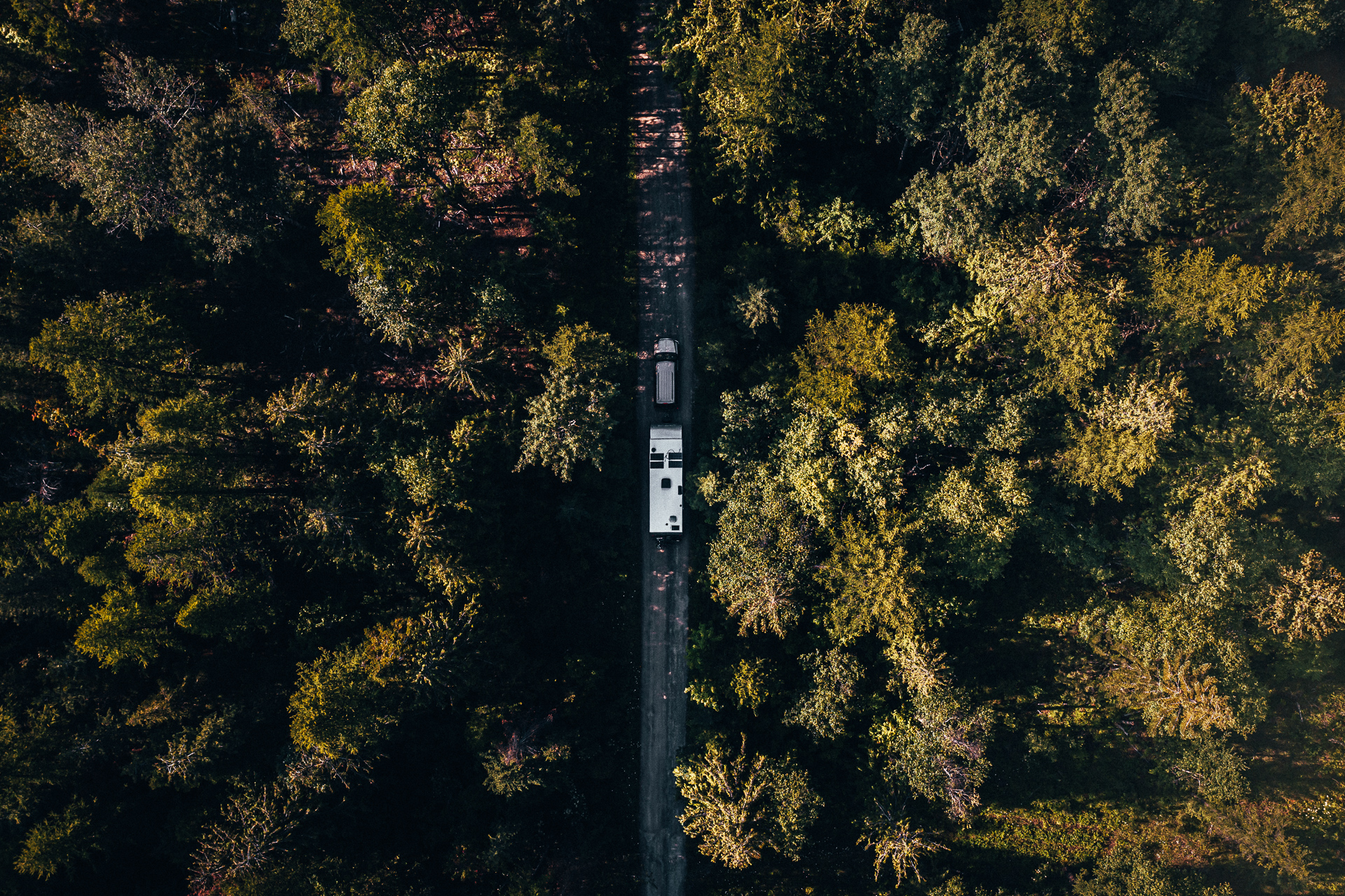 Drone Eye View of us Traveling Down a Dirt Road in Sandpoint, Idaho