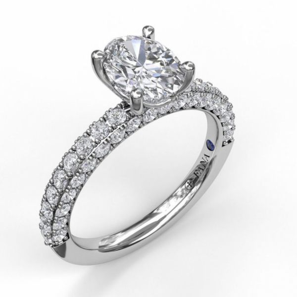 Delicate Oval Cut Solitaire with Diamond-Enhanced Band Parris Jewelers Hattiesburg, MS