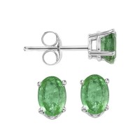 Oval Prong Set Emerald Studs In 14K White Gold
