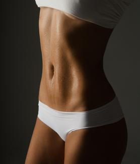 Get a flat belly with these tips