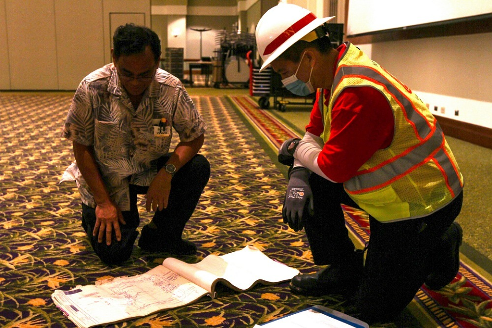 Member of the Army Corps of Engineers Honolulu District discusses the layout of a potential COVID-19 alternate care facility in Kauai, Hawaii, April 3, 2020.