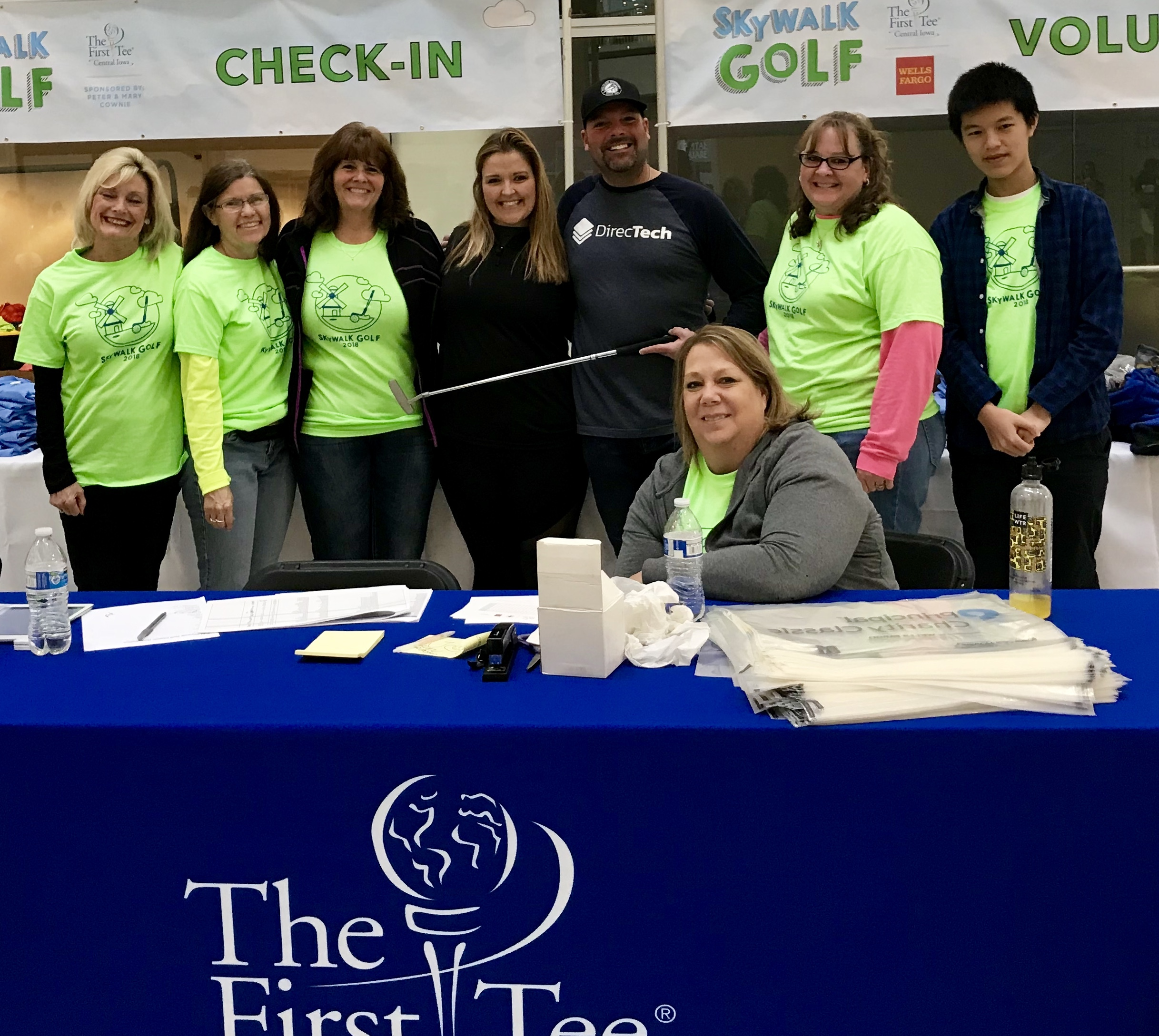 First Tee volunteers and participants, pictured left to right: Darla Jergens, Jan Atchison, Beth Steven, Kari Stone, Dan Tooker, Theresa Nash and Xiangheng Li ; and Sara Robertson, sitting.