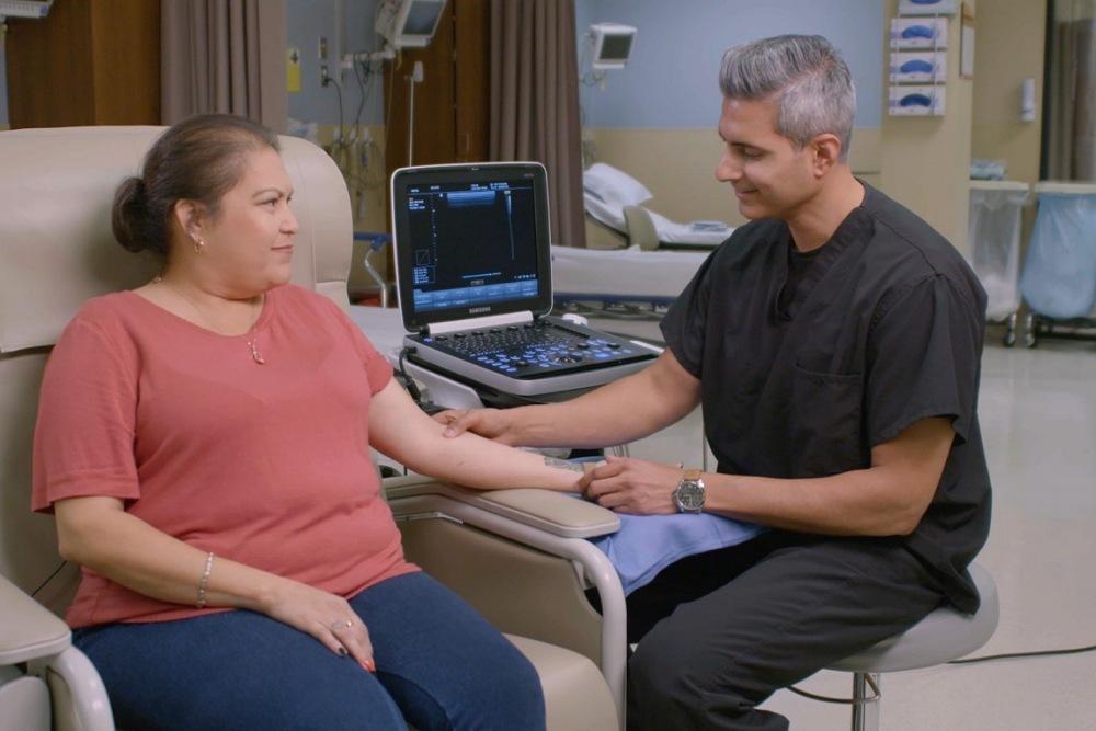 3 / 6Nephrologist Umar Waheed checks the status of Ellipsys patient Theresa Torres' fistula using ultrasound.