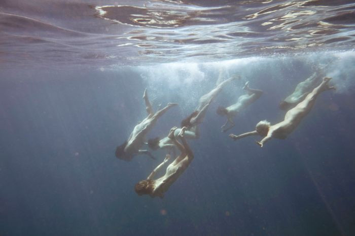 Women swim naked to help renewable energy firms