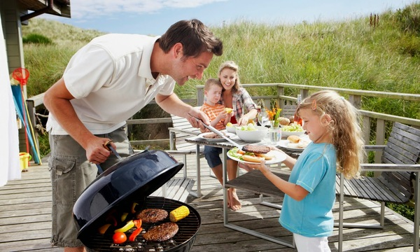 Man grilling family dinner vacation spry