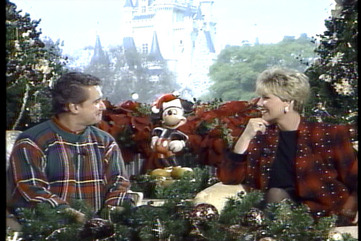Joan lunden and regis philbin chrostmas parade 1991 screen shot looking at eachother%281%29