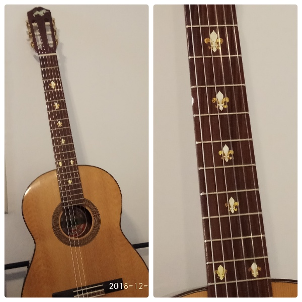 Fleur de Lys inlay on acoustic guitar