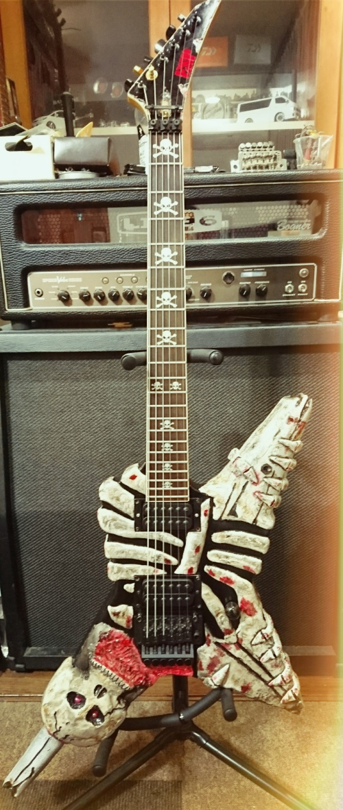 custom guitar in skull bone body with inlay sticker