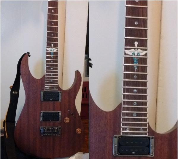 Ibanez natural wood guitar with Caduceus neck inlay sticker