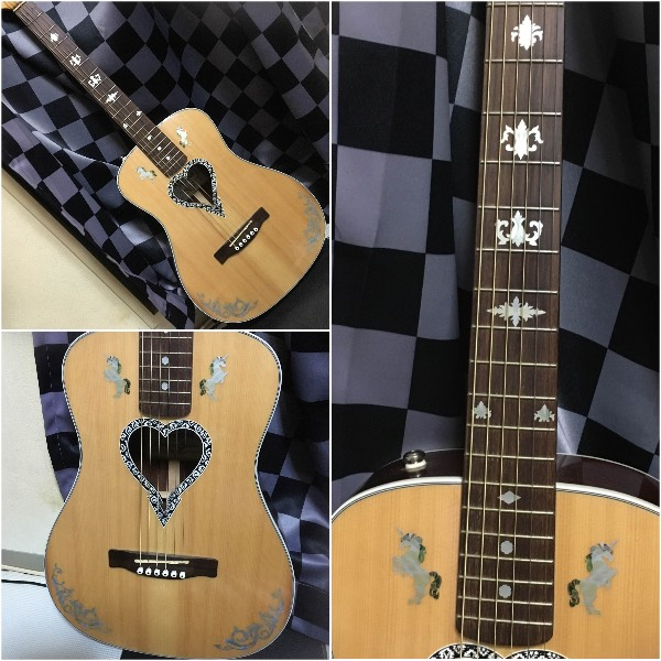 Heart sound hole guitar with unicorn inlay