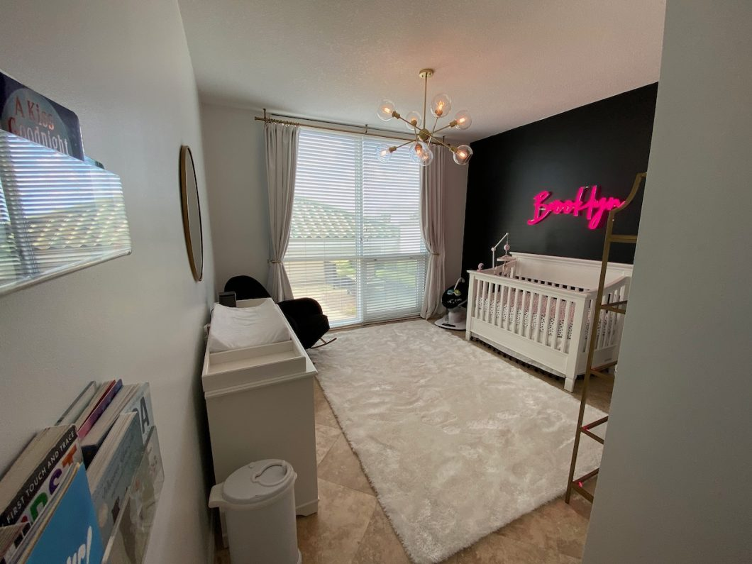 white, black and pink nursery