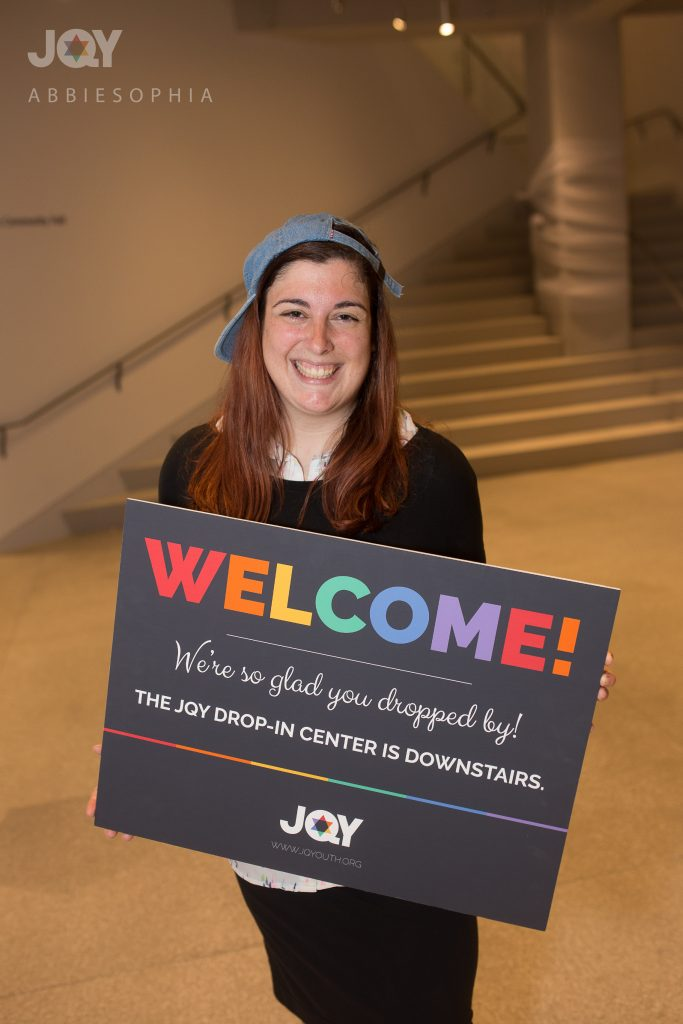 """The JQY drop-in center is a resource I wish I had available to me when I was younger. For so long, I thought I was the only one in the world like me. Today, I am proud of who I am. For me, ""pride"" means that I do not live my life in secret anymore – I am not afraid of being who I am. And though there are some days where that fear creeps back in, I choose to rise above it and my live life as my whole self anyway. I choose to smile. I choose to stand tall. I choose to one day raise a family around a beautiful Shabbos table that I will build. I choose to laugh. I choose love. While I can't go back in time, I can work to make the future better. I want today's Jewish youth to know that they are genuinely not alone. And that they too can be proud of who they are. ALL of who they are."""