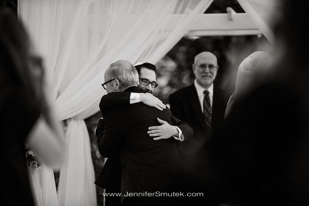 groom hugging father of the bride