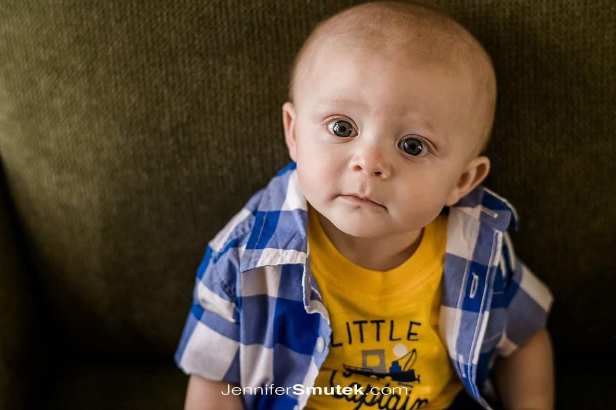 baby in blue plaid shirt