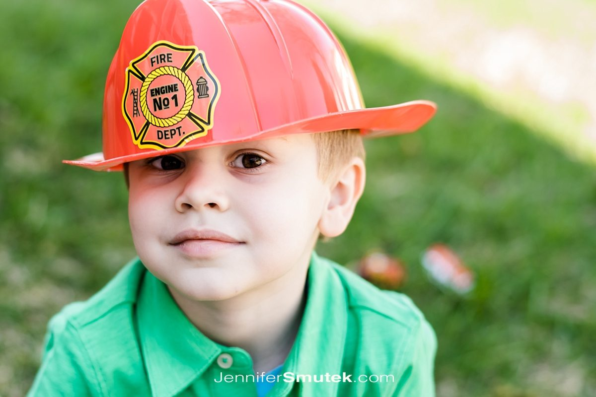 kid in fire truck hat