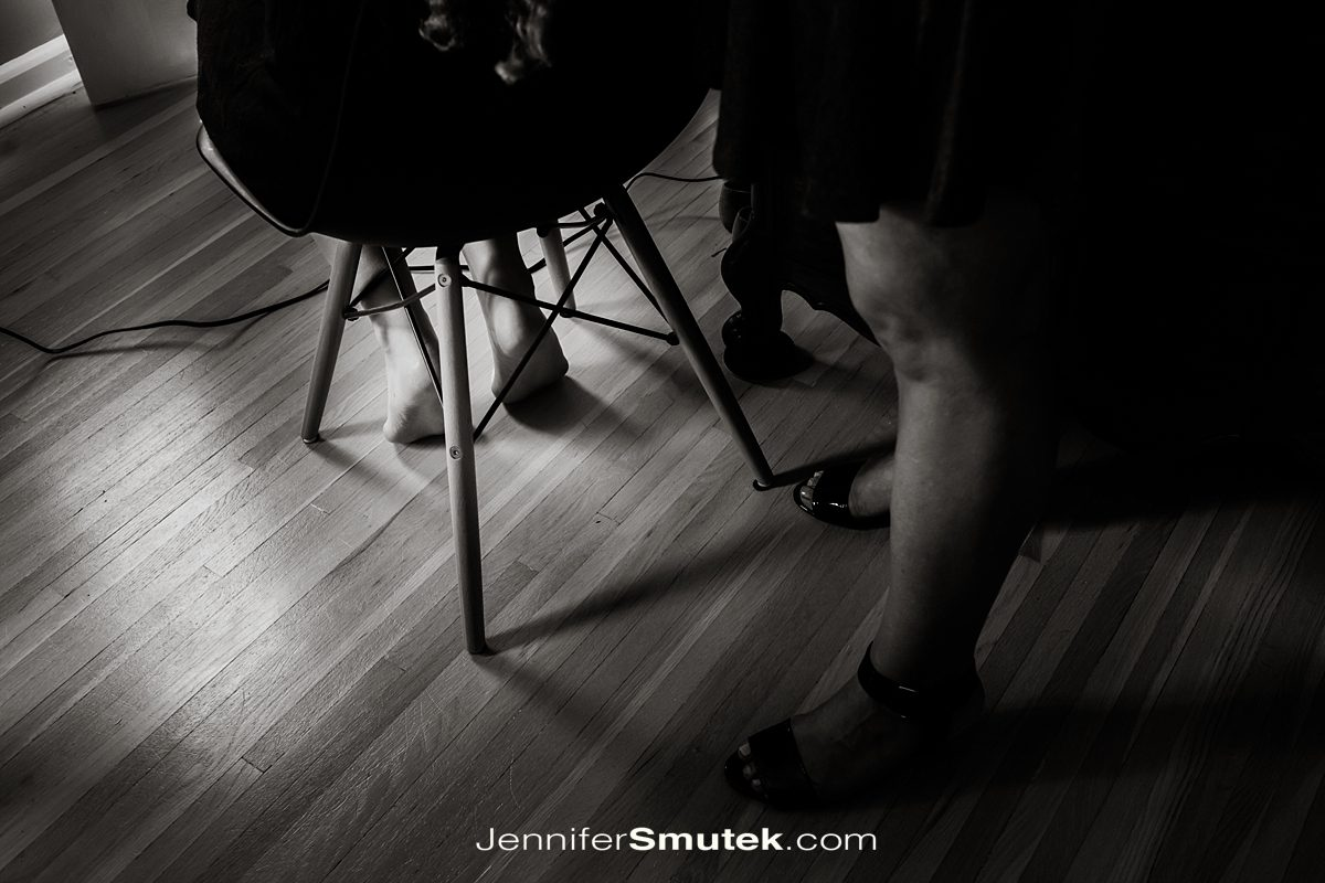 black and white photo of brides feet while getting ready