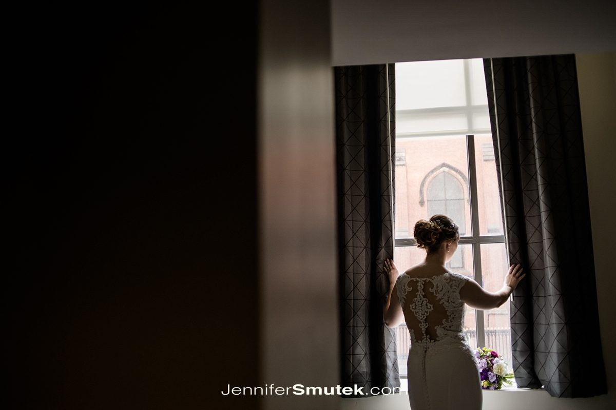 bride in window light at the hotel indigo in baltimore