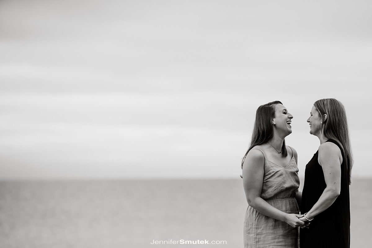 two brides laughing at their Philip Merrill Environmental Center Engagement Session