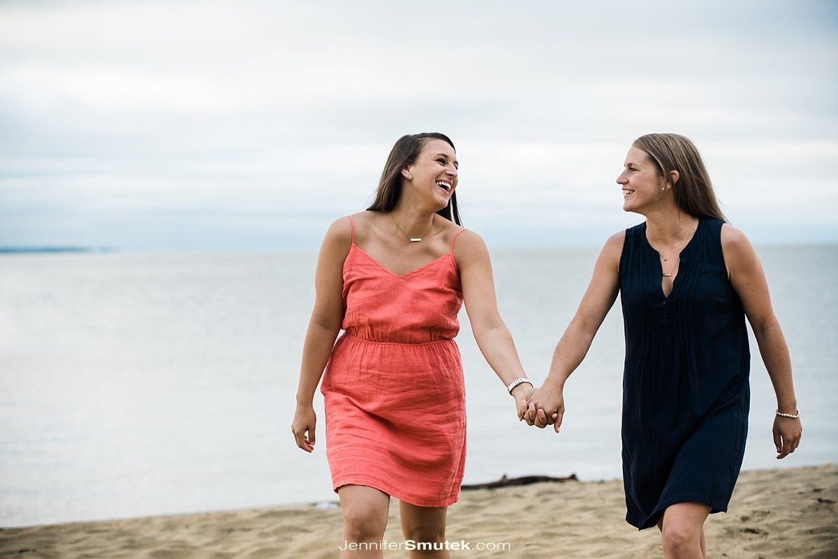 two brides walking along the beach