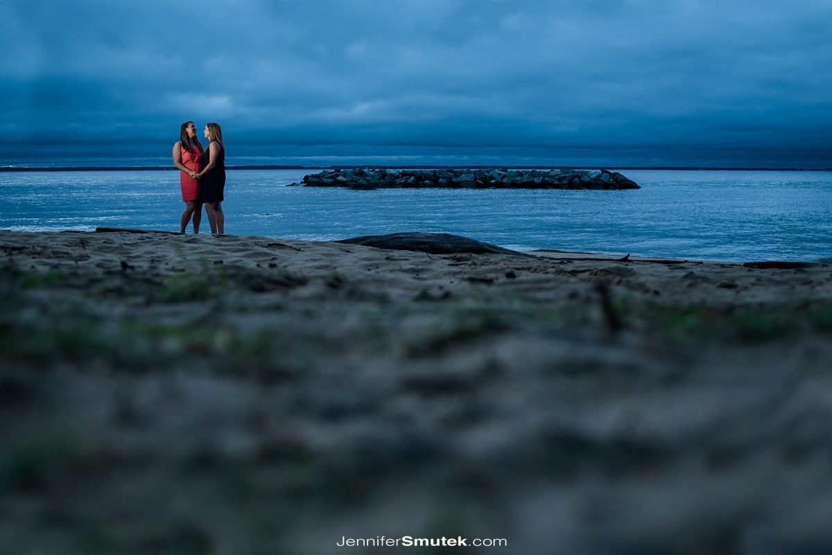 two brides walking along the beach Philip Merrill Enviornmental Center Engagement Session