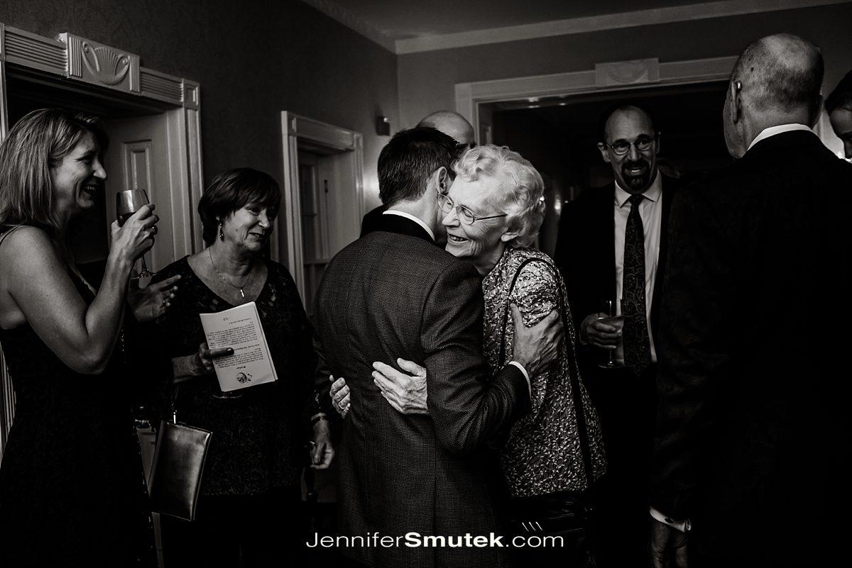 groom hugging family