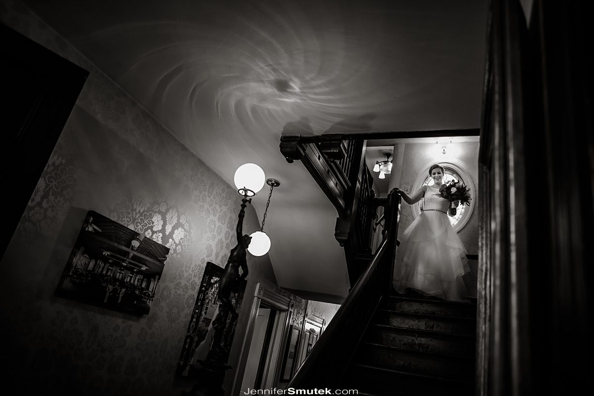 bride walking down the stairs at the Vandiver Inn