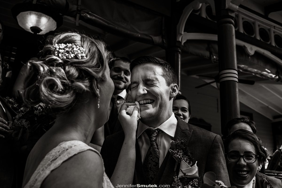 bride wiping grooms mouth fearless wedding photographer