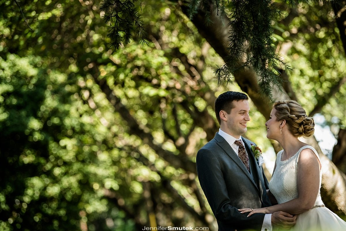 bride and groom under a tree fall vandiver Inn wedding