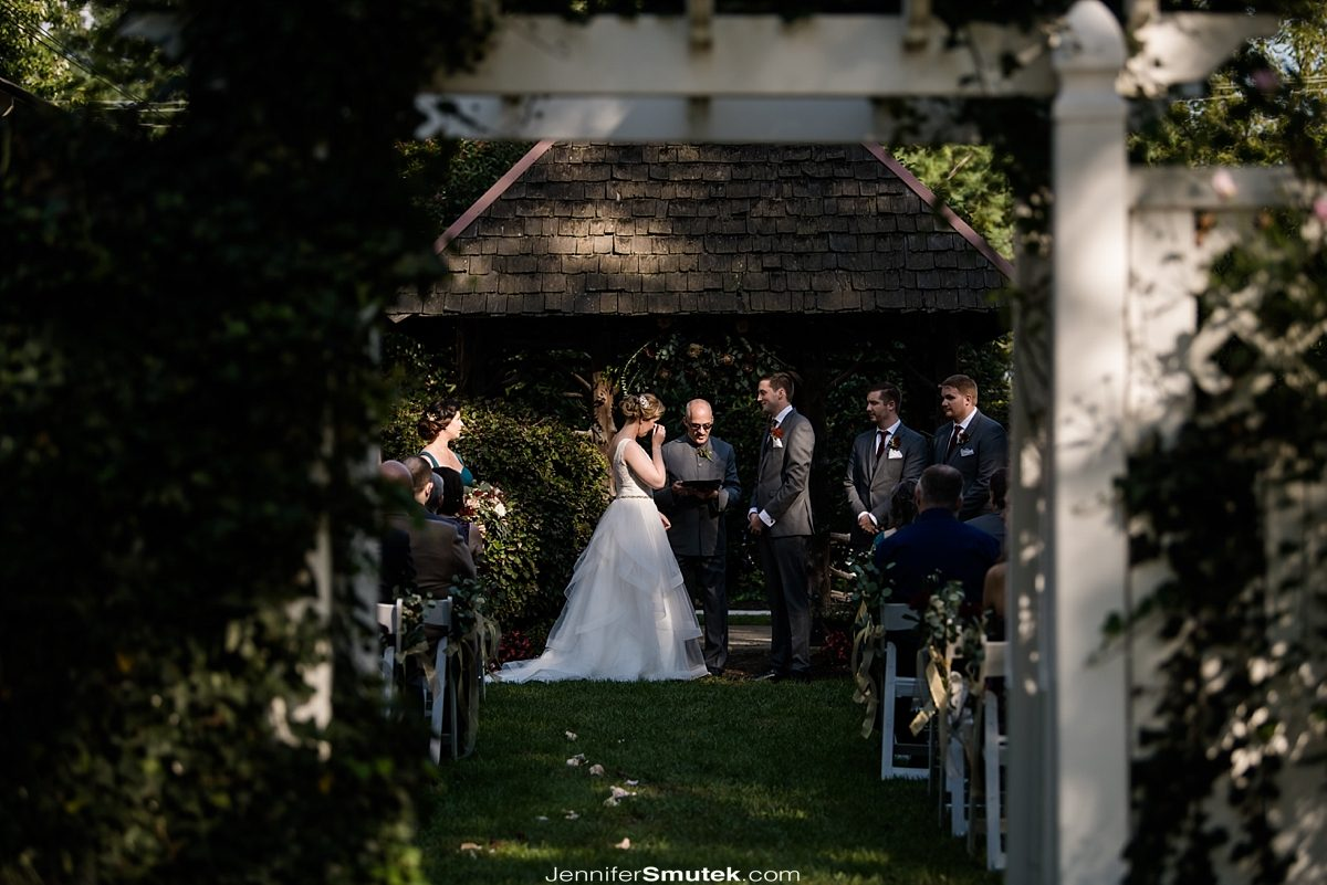 bride crying during fall wedding ceremony at the Vandiver Inn
