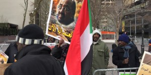 Demonstrators outside the UN demand the arrest of Sudan President Bashir
