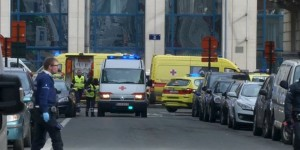 Emergency personnel are seen at the scene of a blast outside a metro station in Brussels, in this still image taken from video on March 22, 2016. REUTERS/Reuters TV