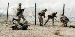 Members of the 1st Battalion, 325th Airborne Infantry Regiment, make their way through concertina wire during a live fire demonstration for Saudi Arabian national guardsmen. The demonstration is taking place during Operation Desert Shield. Source: Wikimedia Commons