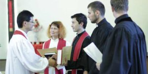 Bishop Eduard Khegay of the Eurasia Episcopal Area ordaining new pastors (Photo: UMC General Board of Global Ministries)