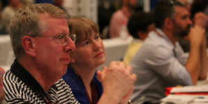 Pastor Bob Land, a UM Action Advisory Board member, and his wife, Amy, watch the proceedings of NCJ2016, to which both were delegates (Photo: NCJ Communications)