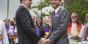 The Rev. Benjamin David Hutchison, right, marries long-time partner Monty Hutchison on Friday, July 17, 2015, outside the Cass County Courthouse. The Rev. Hutchison recently was forced to resign from his post at the Cassopolis United Methodist Church because of his sexuality. Photo by Robert Franklin, courtesy of South Bend Tribune