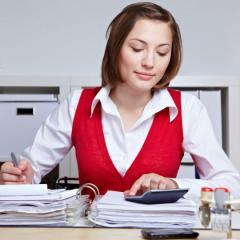 female bookkeeper working with a calculator