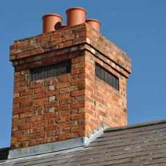 rooftop brick chimney with four flues