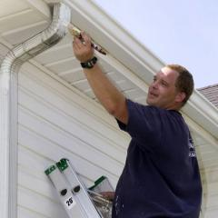 painter painting a gutter leader