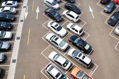 Cars in parking lot spaces